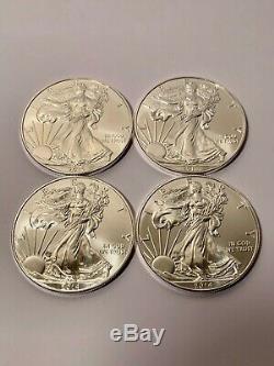 Lot of 4 2014 American Eagle Coins 1 oz. 999 Fine Silver BU Brilliant $1 Coin